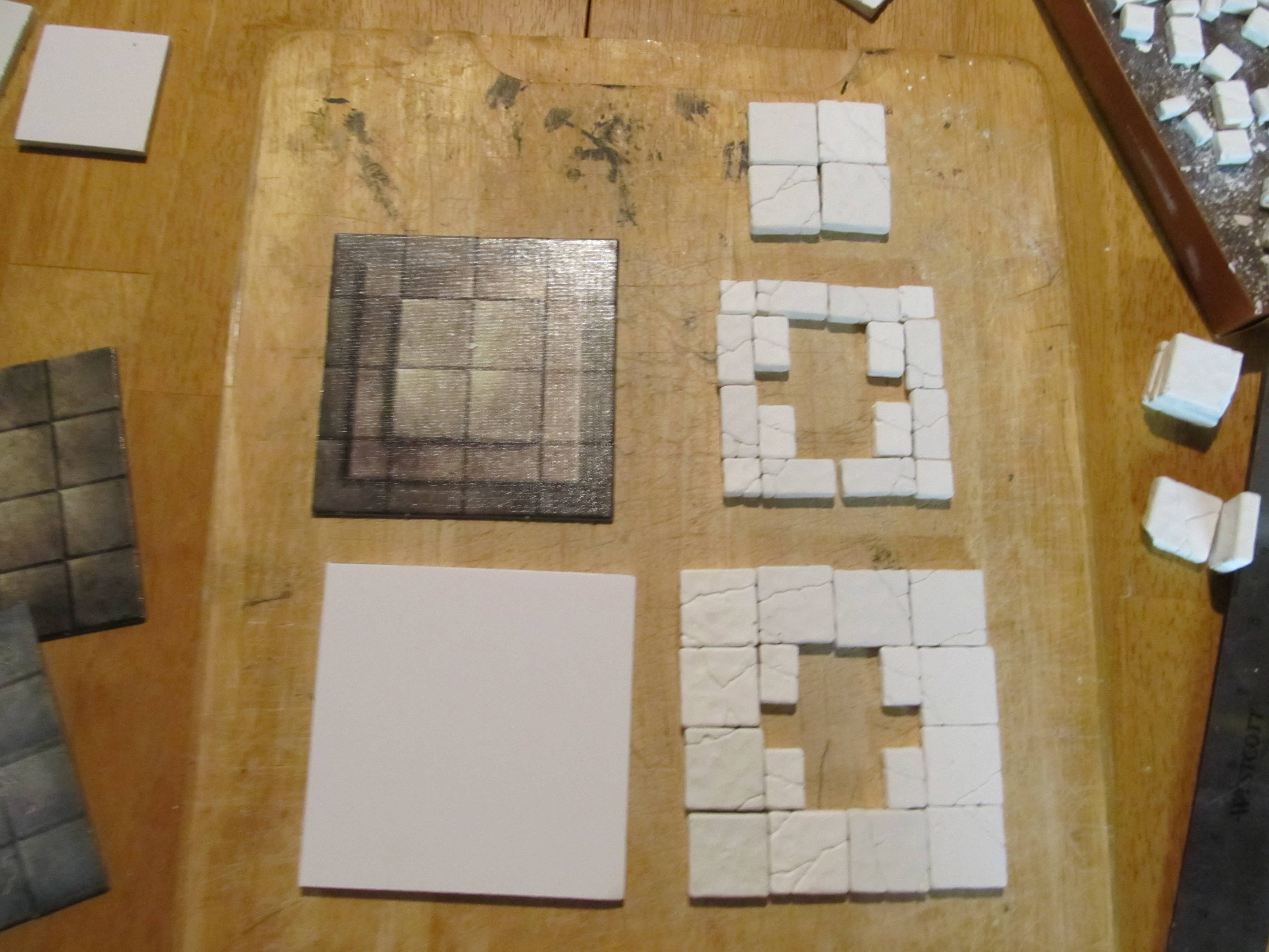 Planning prevents mistakes when it comes time to gluing. Here are the pieces laid out for the pedastal.