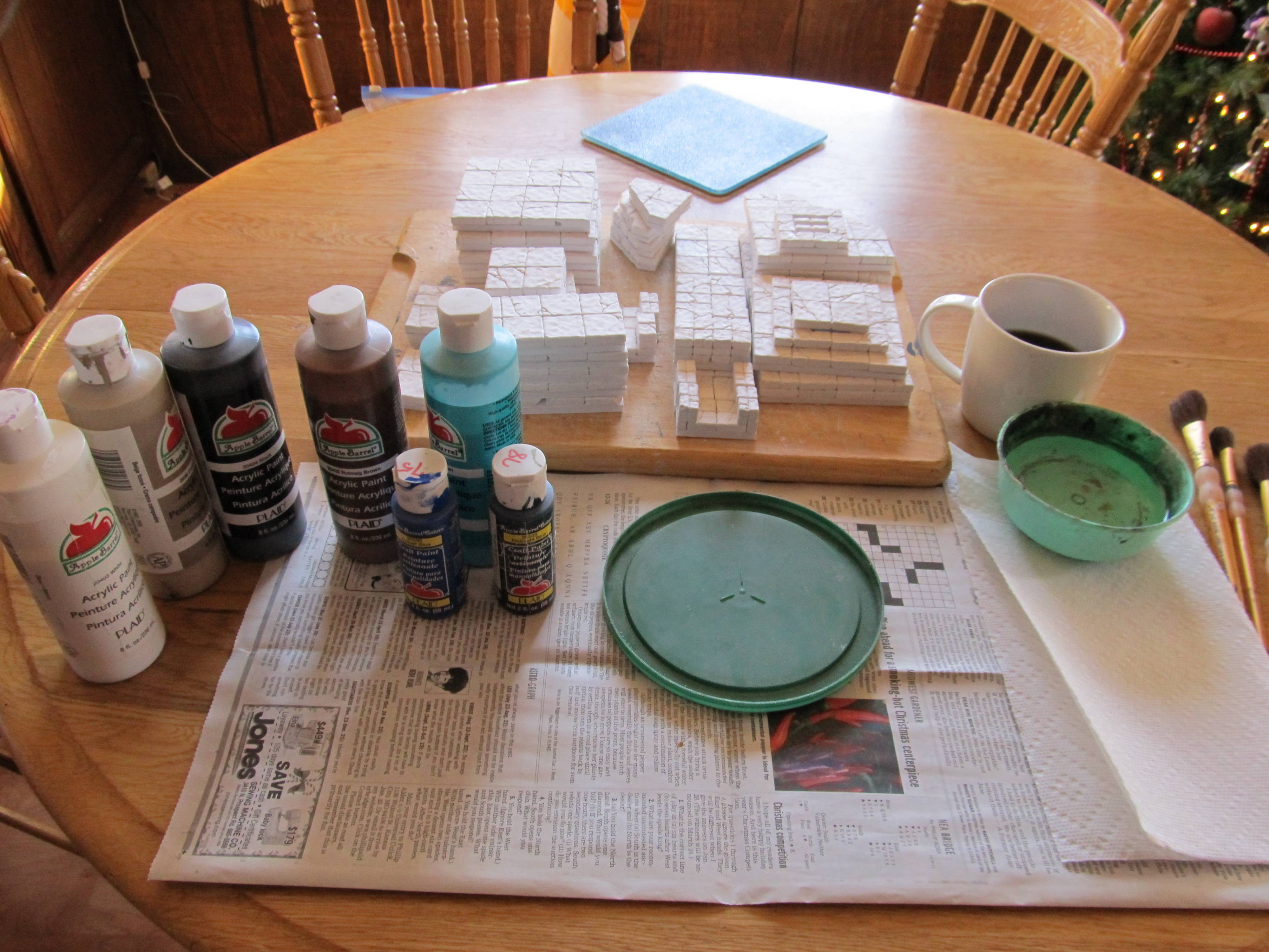 Gather your painting supplies before you begin. Acrylic paints, brushes, a water dish and a pallet for mixing the paint. You'll be using a lot of paper towels, too.